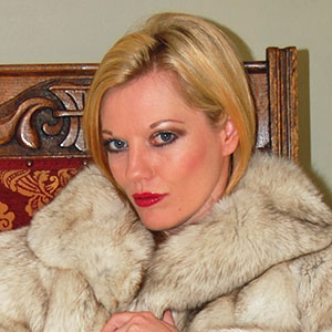 Holly Kiss in blue fox fur coat