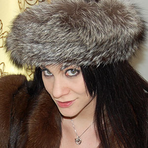 Roxy Mendez in brown mink and fox fur coat and silver fox fur hat