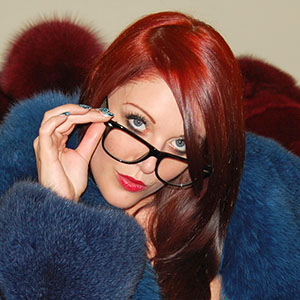 Shay Hendrix in blue fox fur jacket