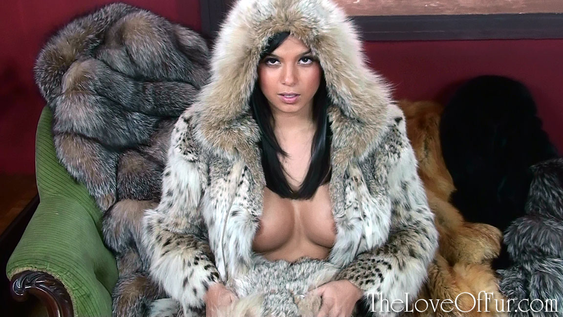 Sasha strips from lynx fur jacket in her lounge