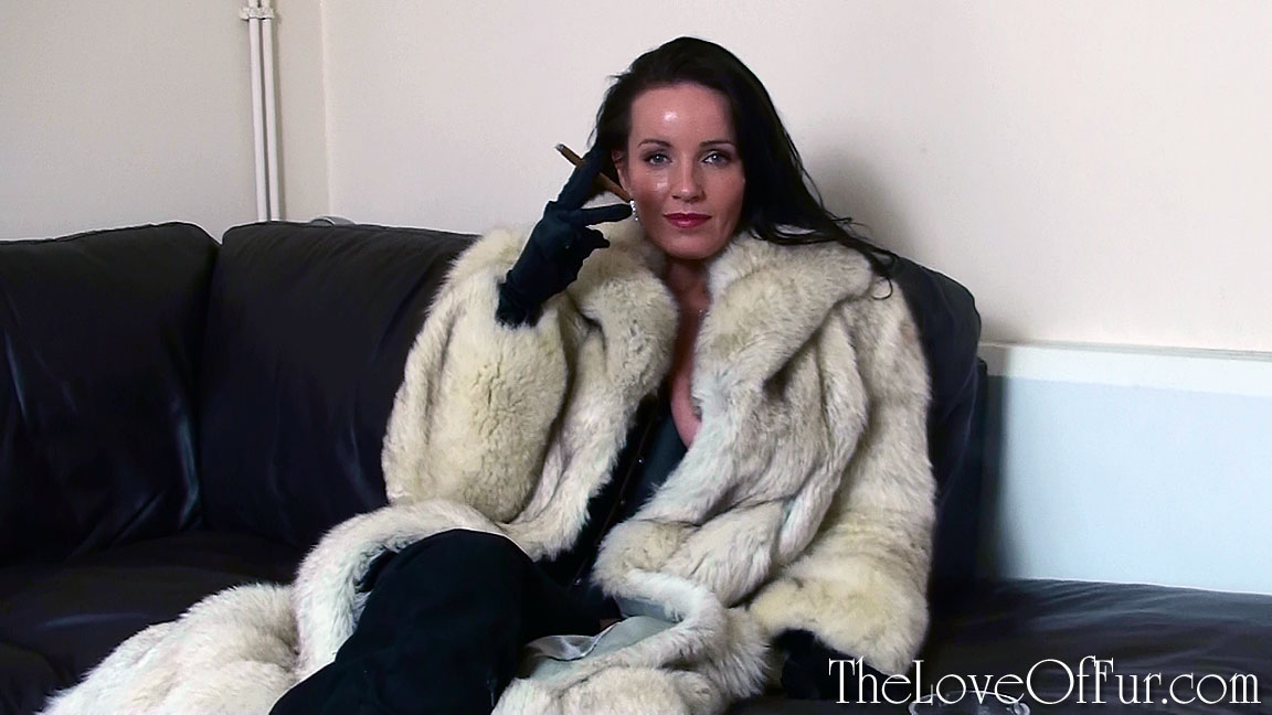 Marlyn Lindsay in blue fox fur coat smoking indoors