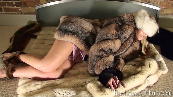 Shay Hendrix is cuffed and blindfolded in soft fox furs