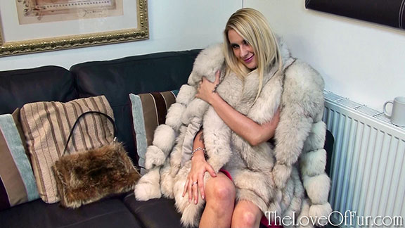 Jessica Lloyd snuggles up in blue fox furs