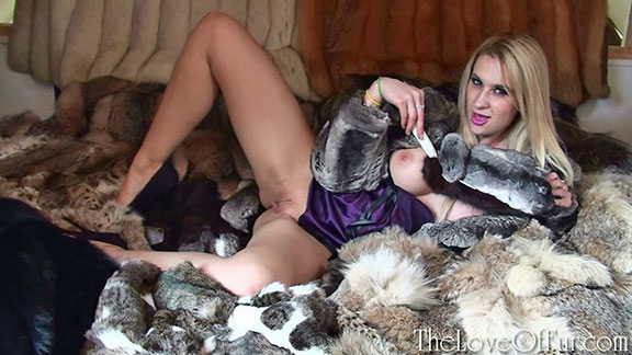 Jessica Lloyd on her sexy fur bed in chinchilla fur jacket and purple satin