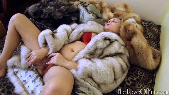 Niki enjoys her dildo alone wearing many fox fur coats
