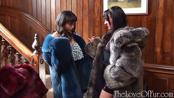 Alyssa Divine in blue fox fur jacket listens to fashion tips from Madame Chloe Lovette in silver fox