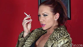 Ashleigh Embers smokes a cigarette wearing ocelot fur