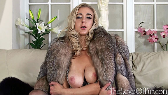 Busty blonde Sapphire Blue shows her big tits in crystal fox fur coat