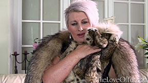 Sexy milf Sally Taylor in crystal fox fur cuddles her lynx jacket