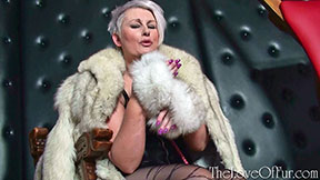 Milf mistress in fox fur coat fur handcuffs and stockings Sally Taylor
