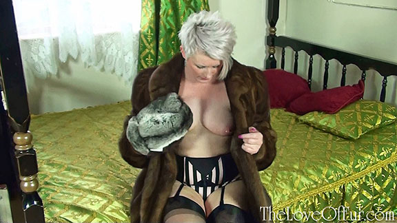 Milf Sally Taylor in mink coat rubs her big tits with fur mittens